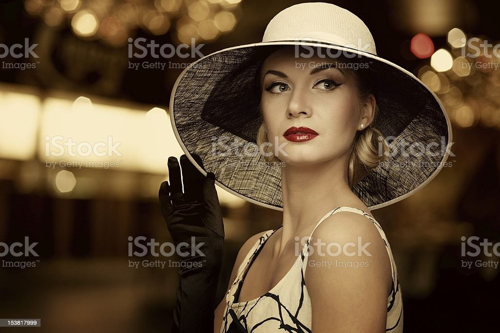 Fashionable woman in hat, blurred background stock photo