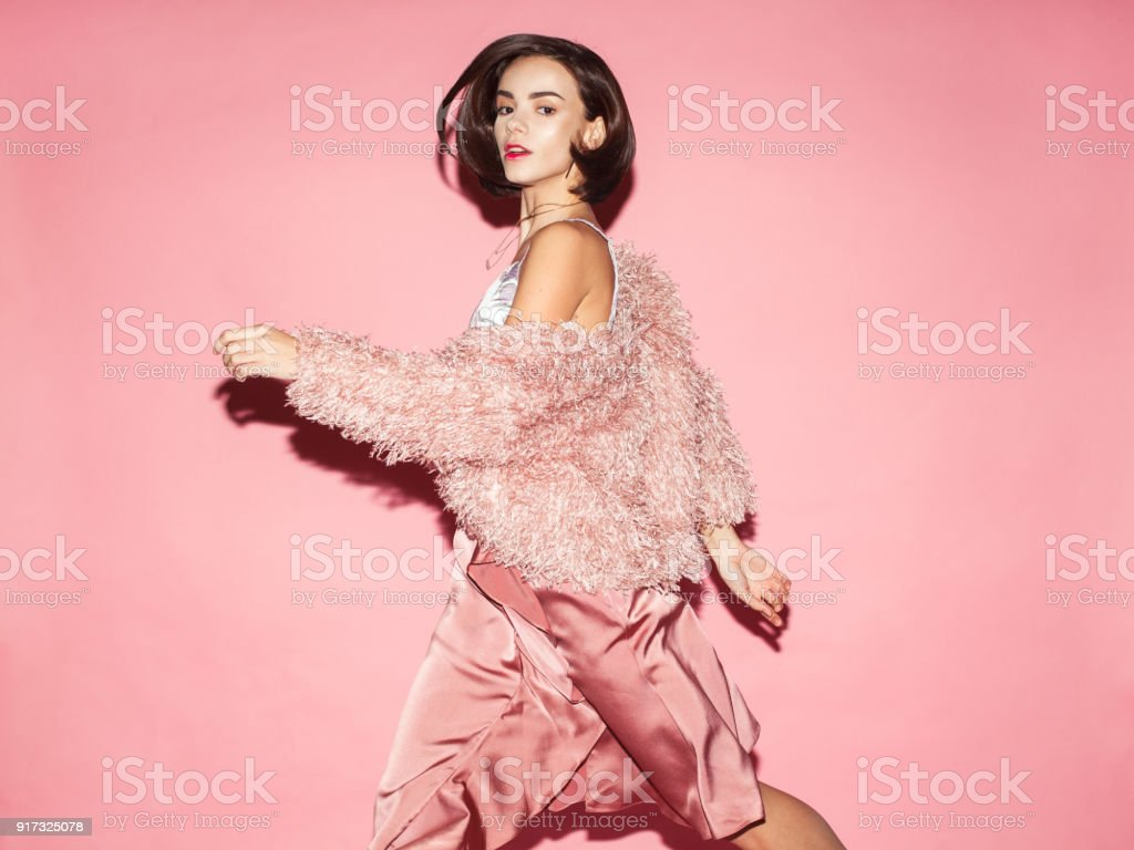fashionable woman in pink dress on pink background royalty-free stock photo