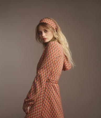 Portrait of beautiful fashionable woman wearing print dress, 70s style