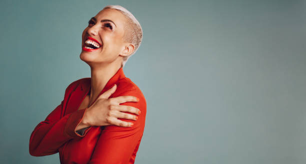 Fashionable woman looking away and laughing stock photo