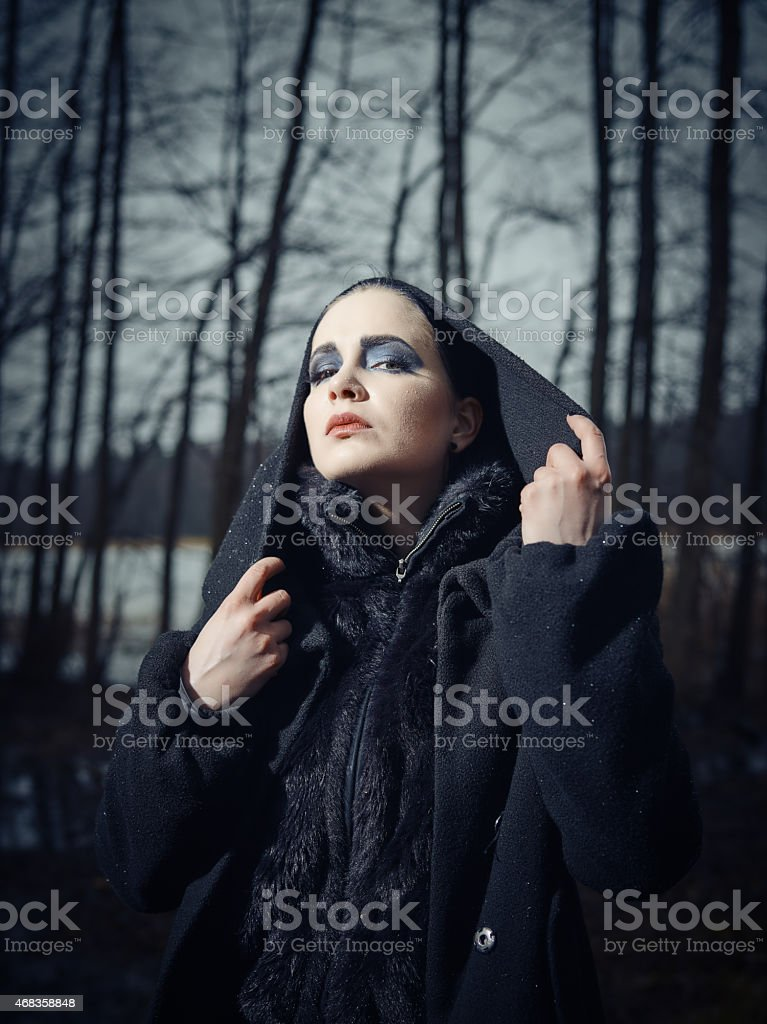 Fashionable woman, outdoor posing in March royalty-free stock photo