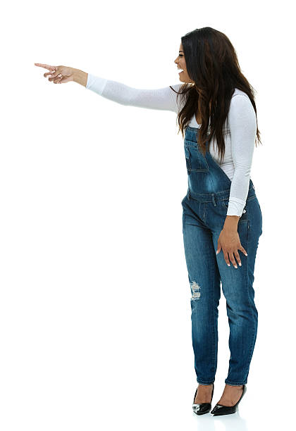Fashionable woman pointing away stock photo