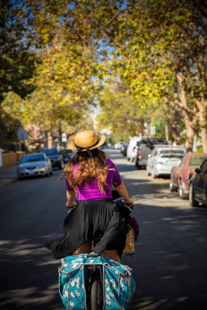 Fashionable Woman Riding Cargo Bike - Rear View stock photo