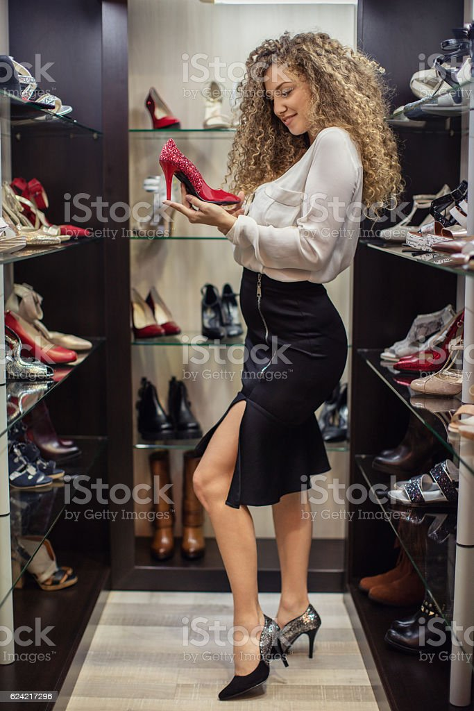 Fashionable woman shooping in shoes retail store stock photo