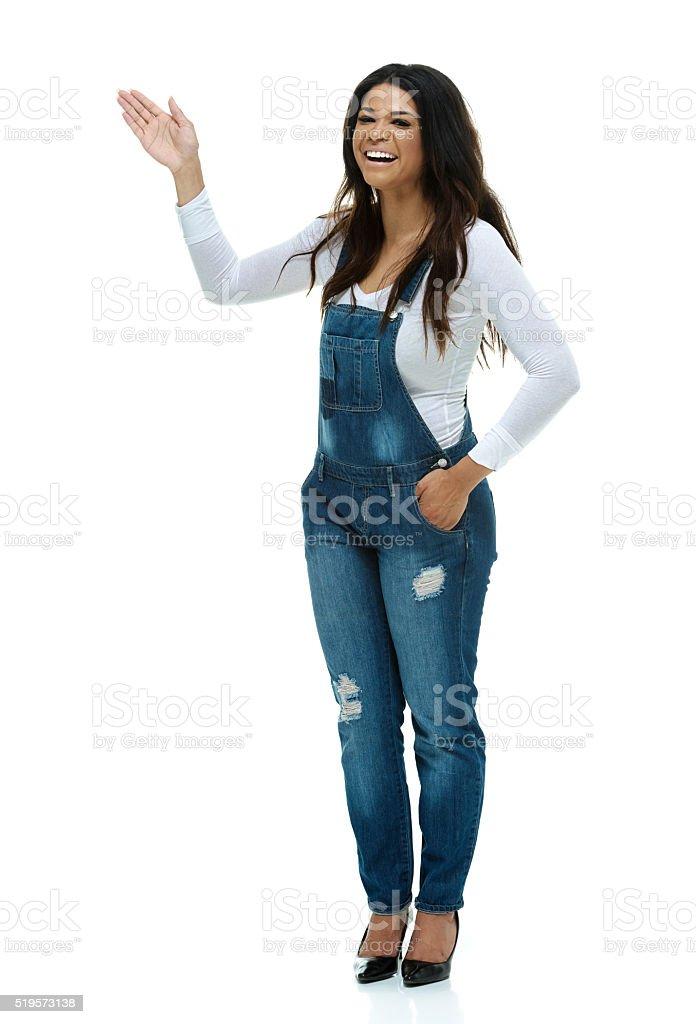 Fashionable woman waving hand stock photo