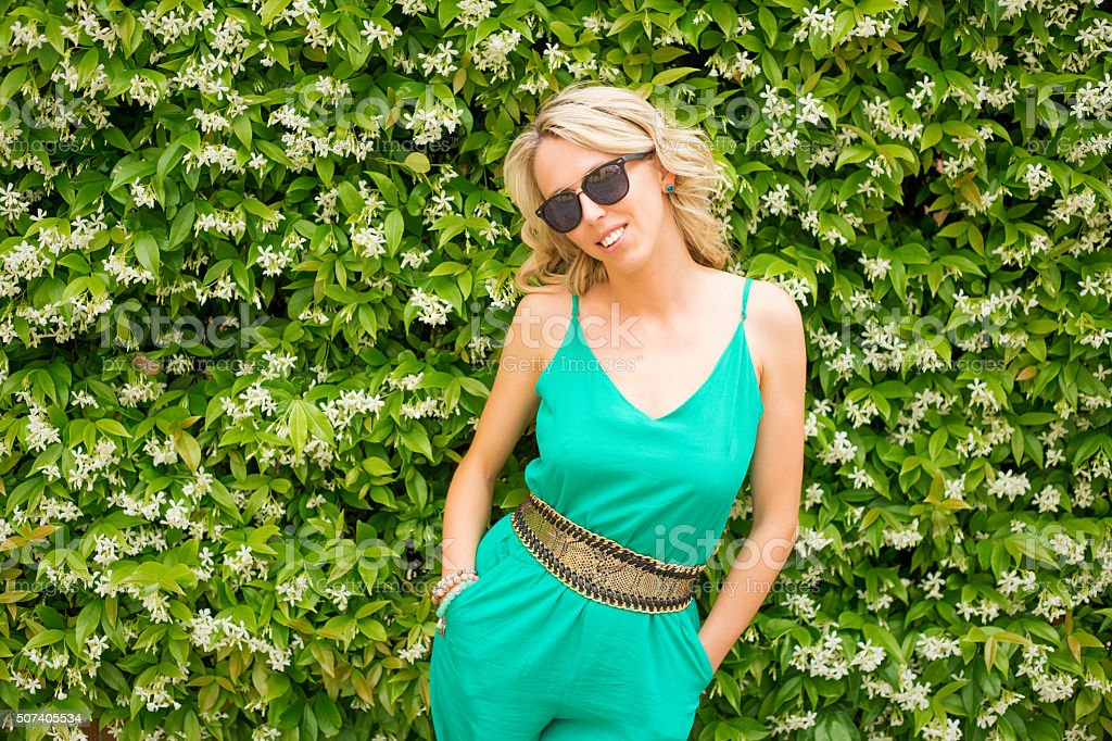Fashionable woman wearing green jumpsuit stock photo