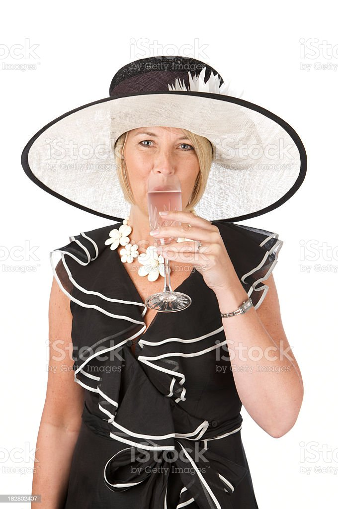 Fashionable woman wearing hat drinking pink champagne on white background royalty-free stock photo