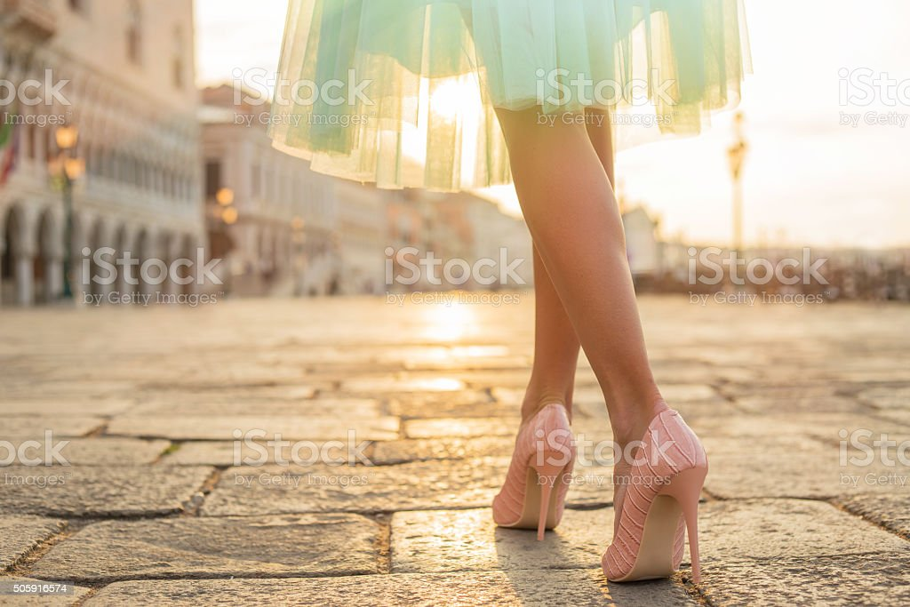 Fashionable woman wearing high heel shoes stock photo
