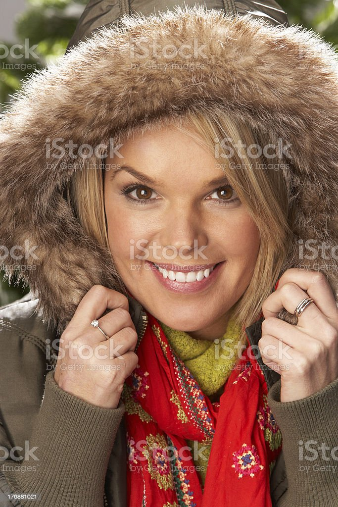 Fashionable Woman Wearing Parka Coat And Scarf In Studio royalty-free stock photo