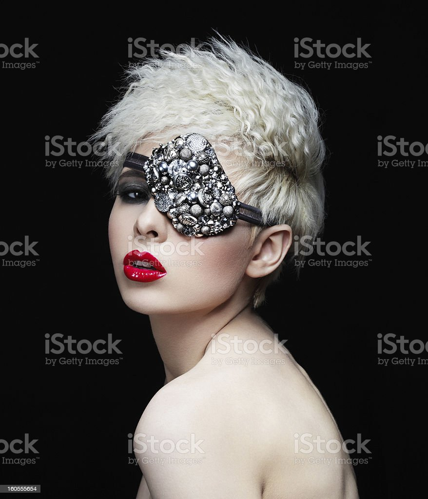 Fashionable woman with eye mask royalty-free stock photo