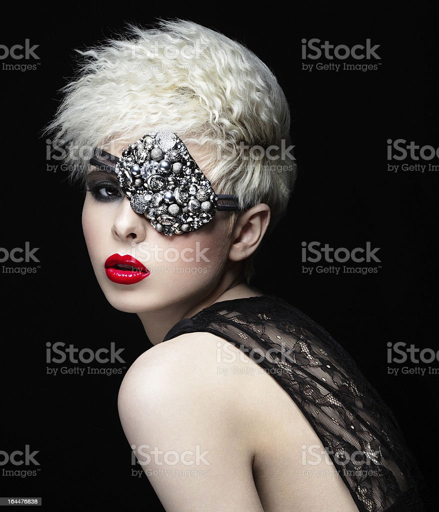 Fashionable woman with eye patch stock photo