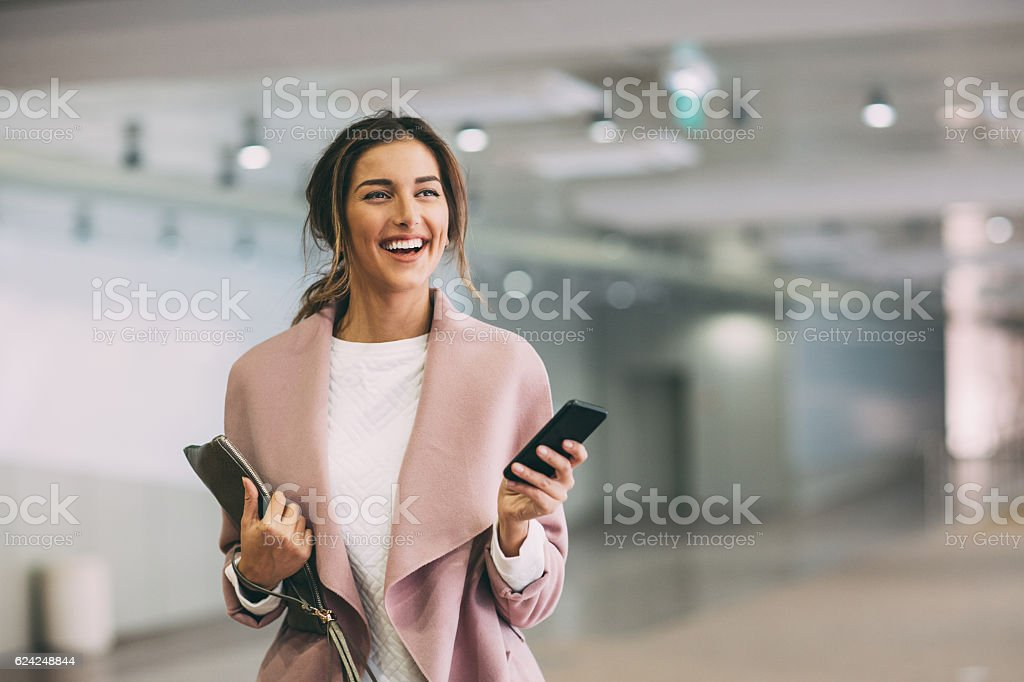 Fashionable woman with phone at subway parking lot stock photo