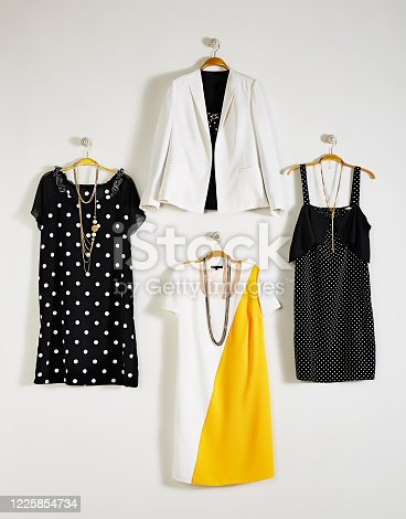 Fashionable women's clothing with personal accessories on coathanger isolated on white background(with clipping path)