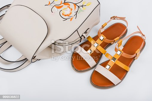 istock Fashionable women's sandals and backpack on white background 999536822