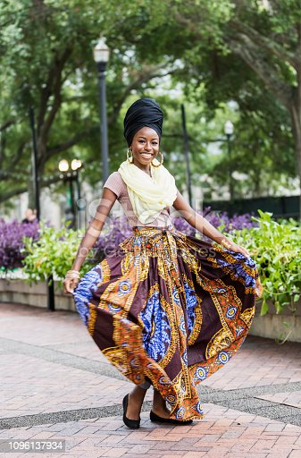 istock Fashionable young African-American woman 1096137934
