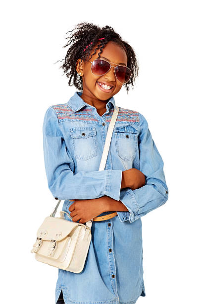 fashionable young girl posing with sunglasses and purse on white - kinderhandtaschen stock-fotos und bilder