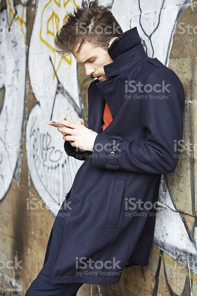 Fashionable Young Man Texting royalty-free stock photo