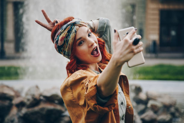 fashionable young woman chatting over smartphone stock photo