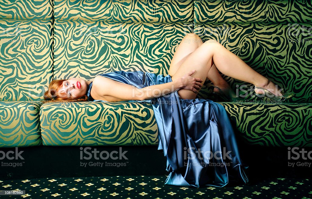 Fashionable Young Woman Laying on Floor royalty-free stock photo