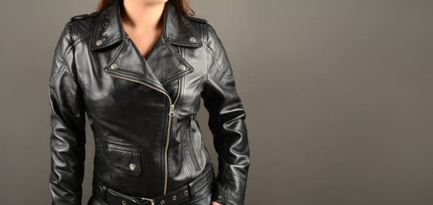 fashionable young women wearing bikers leather jacket fashionable young women wearing bikers leather jacket isolated on gray with free space for your textual ideas. leather jacket stock pictures, royalty-free photos & images