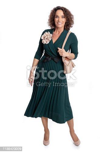 istock Fashionably dressed mature woman 1135420029