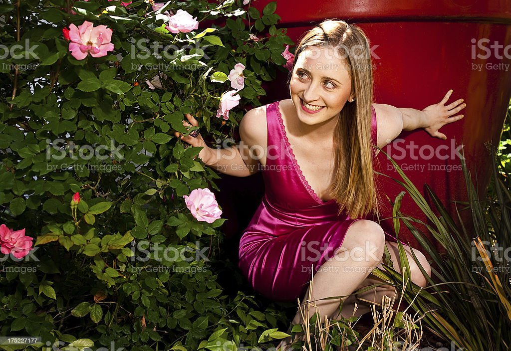 Fashonable Woman in the Flowers royalty-free stock photo