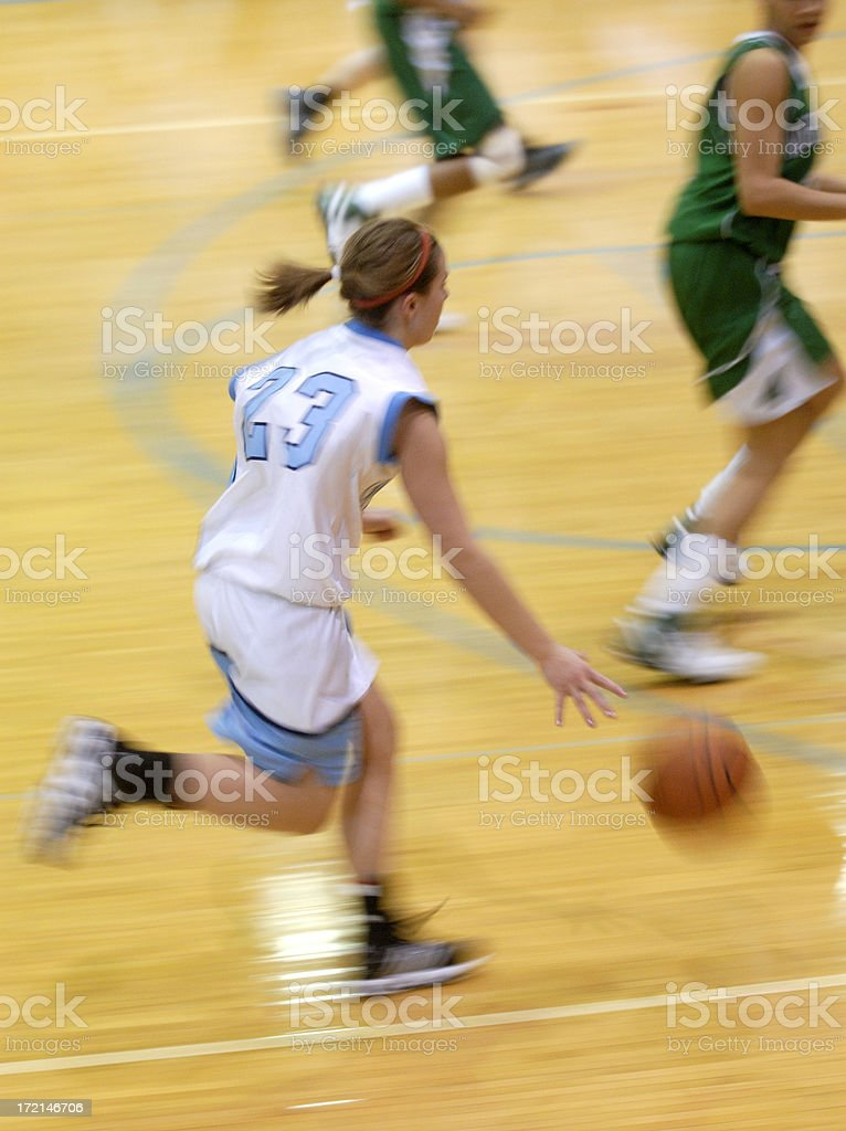 Fast action girls basketball stock photo