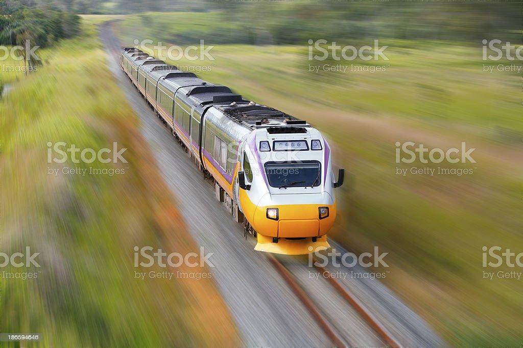 Fast aerodynamic diesel train blurred at speed stock photo