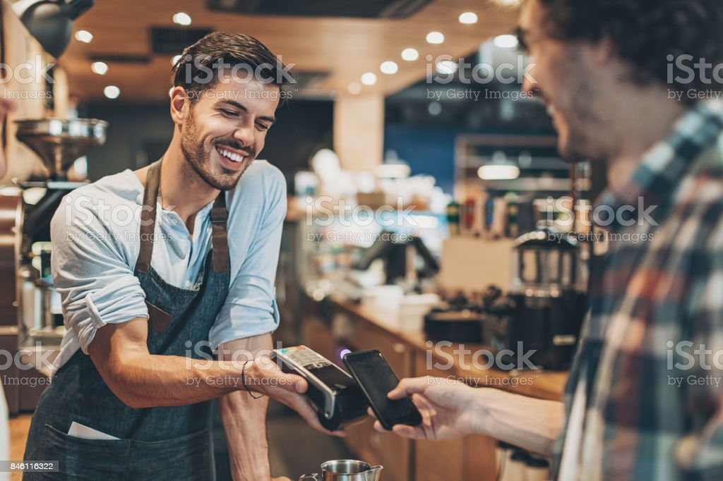 Fast and easy payment in the coffee shop - foto stock