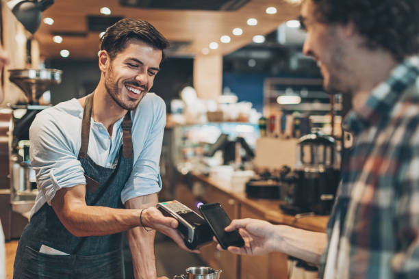 Fast and easy payment in the coffee shop stock photo