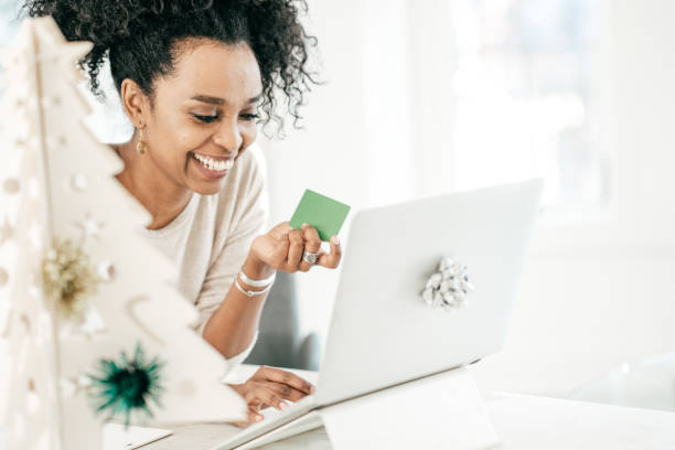 Fast and efficient online shopping Women buying online with credit card gift card stock pictures, royalty-free photos & images