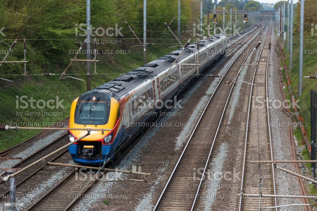 Fast British passenger train in motion stock photo