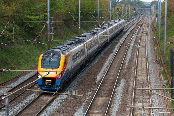 fast british passenger train in motion - land vehicle stock photos and pictures