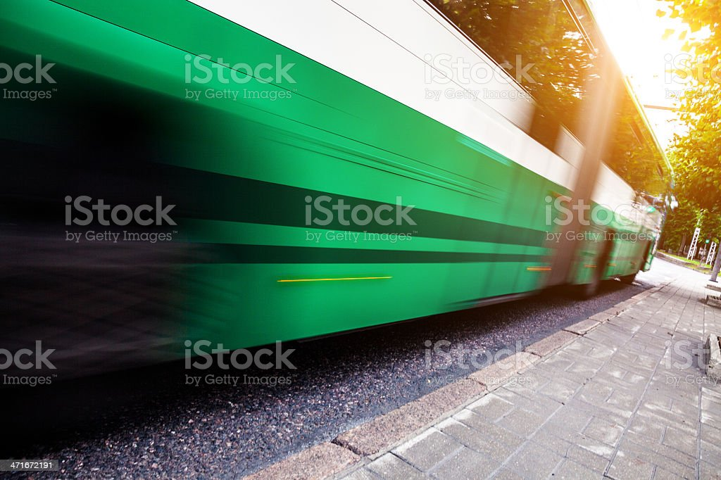 Fast bus in the city traffic at rush hour royalty-free stock photo