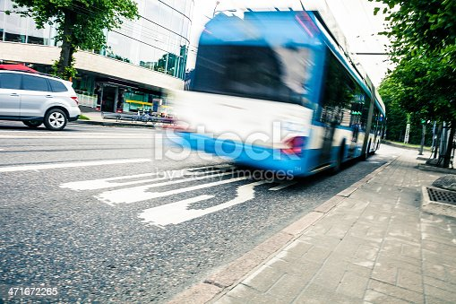 1060957508istockphoto Fast bus in the city traffic at rush hour 471672265