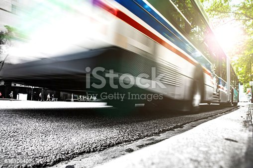 1060957508 istock photo Fast bus in the city traffic at rush hour 616106402