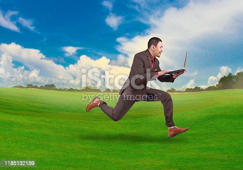 509644623 istock photo Fast Businessman Running While Carrying Laptop 1185132159