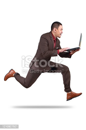 509644623 istock photo Fast Businessman Running while Carrying Laptop 1210927521