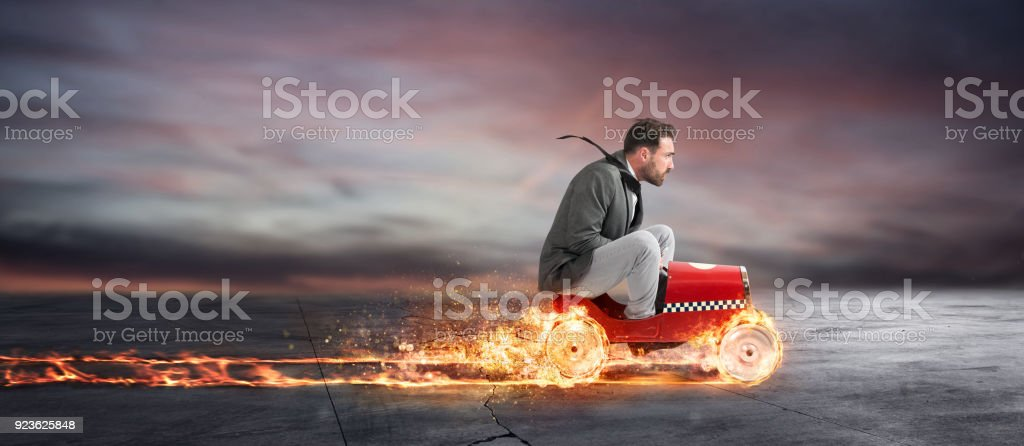 Fast businessman with a car wins against the competitors. Concept of success and competition foto stock royalty-free