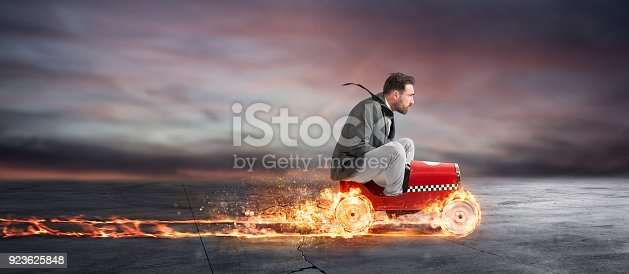 istock Fast businessman with a car wins against the competitors. Concept of success and competition 923625848