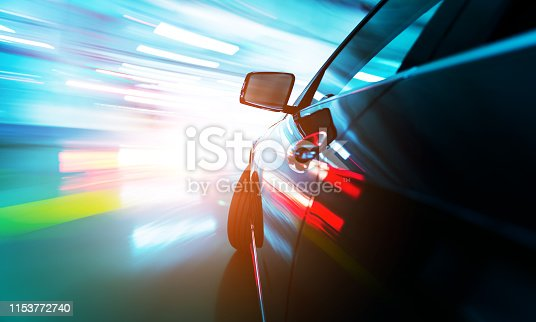 640042252 istock photo Fast car in parking, blurred motion 1153772740