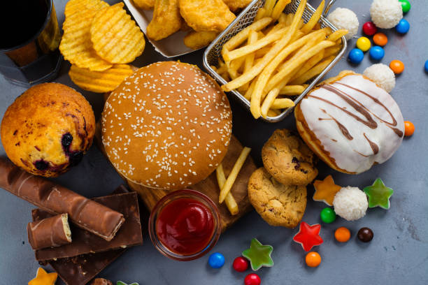 Fast carbohydrates food Assortment of unhealthy products that's bad for figure, skin, heart and teeth. Fast carbohydrates food. Space for text unhealthy eating stock pictures, royalty-free photos & images