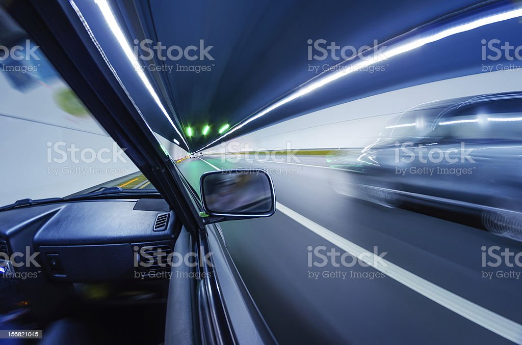 Fast cars in tunnel royalty-free stock photo