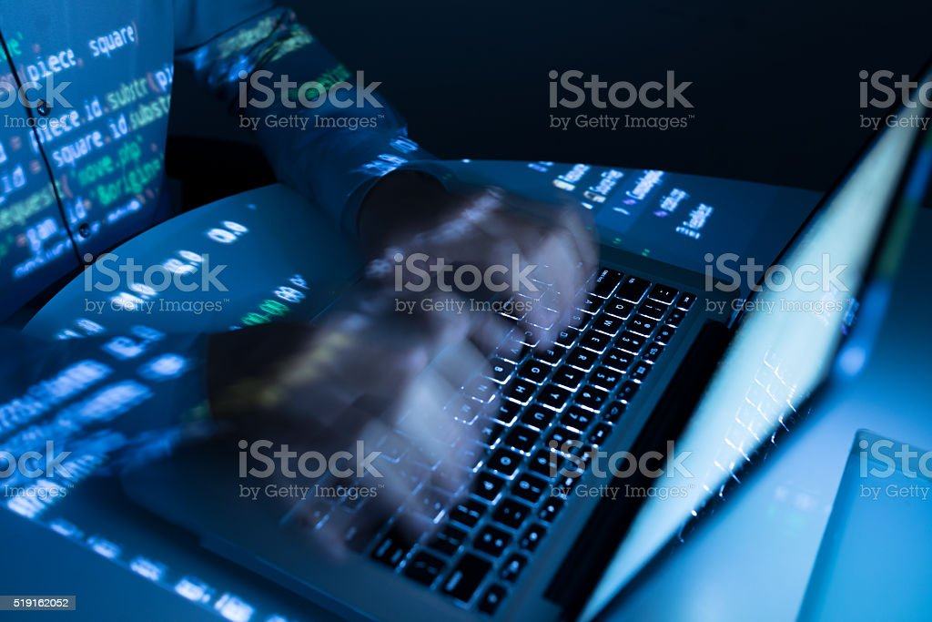 Fast coding Hands of coder typing very fast, blurred motion Adult Stock Photo