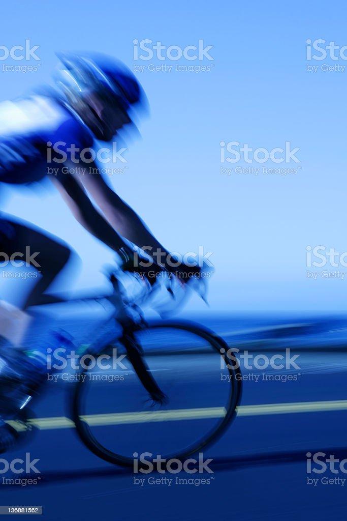 XL fast cyclist stock photo