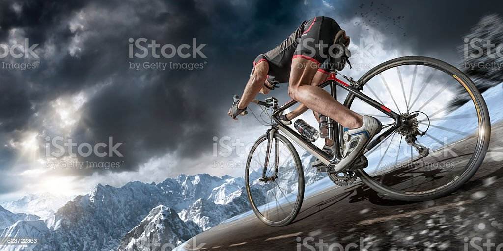 Fast Downhill Cyclist in the Alps stock photo
