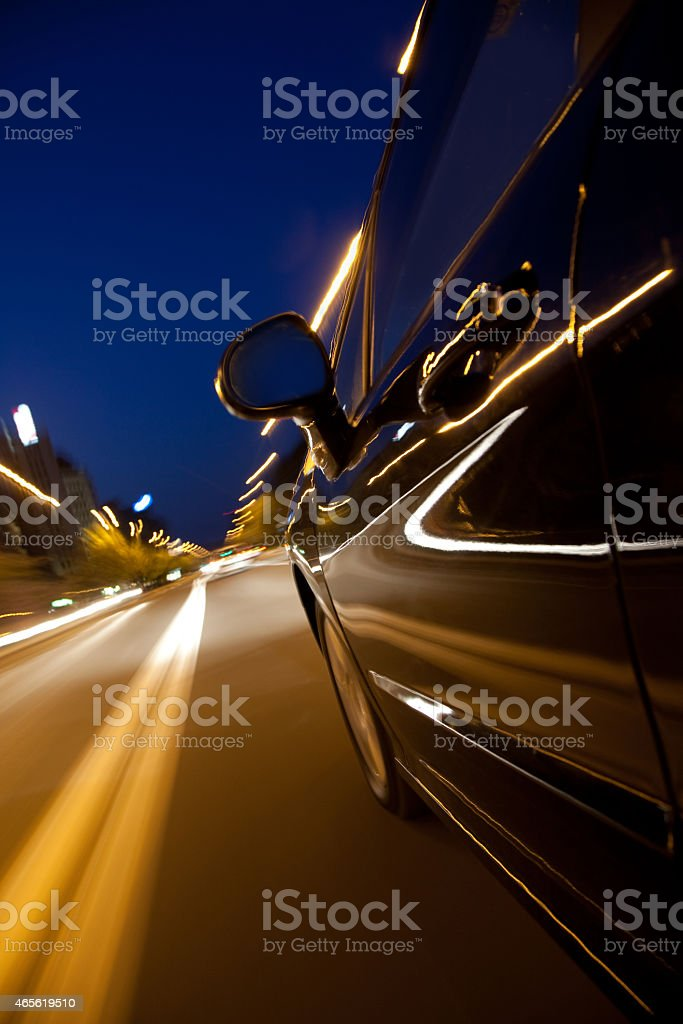 fast driving trough night city avenue stock photo