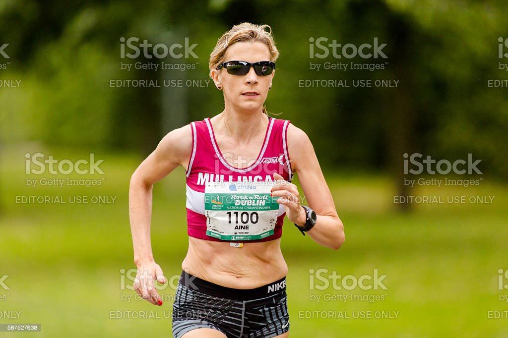 Fast female runner stock photo