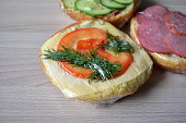 istock Fast food and sandwiches with sausage and vegetables in polythene 1216429521