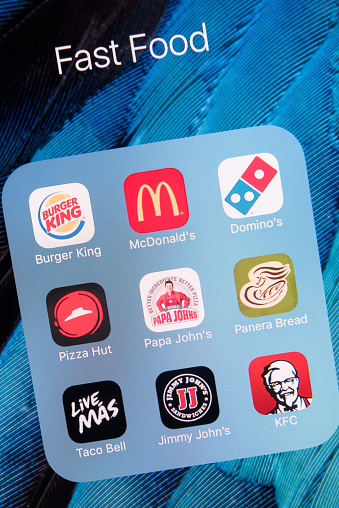 Fast Food Apps On Apple Iphone 6s Plus Screen Stock Photo - Download